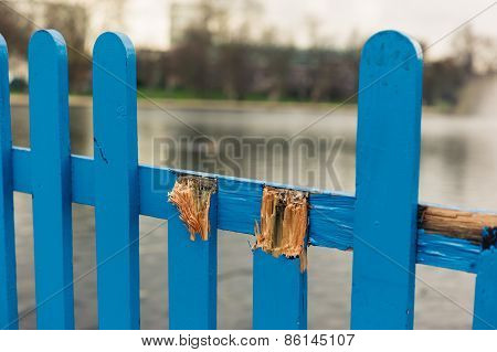 Broken Fence By A Pond