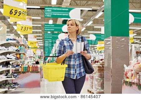 Woman Housewife Shopping In Supermarket