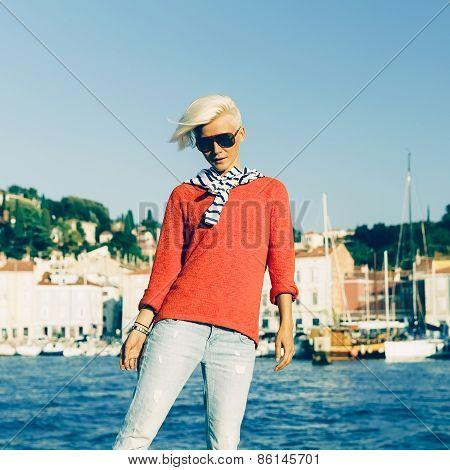 Fashion Portrait Stylish Blonde Girl On Vacation. Marine Style