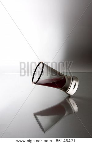 three red white wine glasses standing in a row