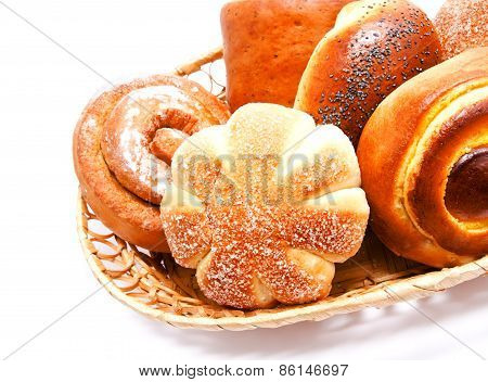 Fresh Sweet Buns And Rolls With Poppy And Cream In The Basket