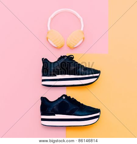 Trendy White Headphones And Sneakers On Vanilla Background. Urban Summer Time