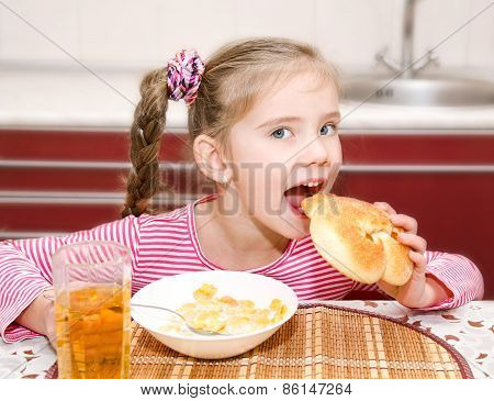 Cute Smiling Little Girl Having Breakfast Cereals With Milk