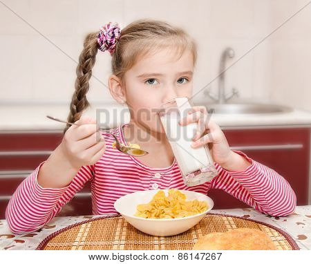 Cute Little Girl Having Breakfast Drinking Milk