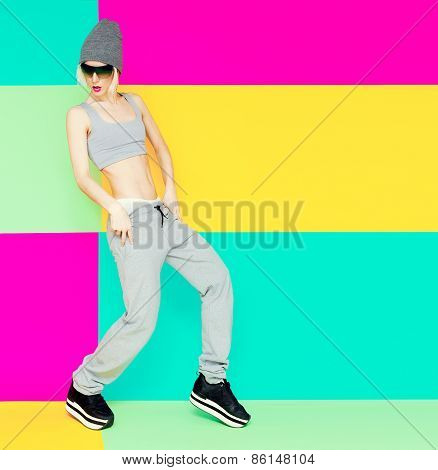 Girl Dancer On Bright Background. Lifestyle, Sports Clothes, Fashion Style