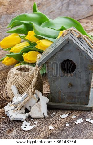 easter decorations with yellow tulips