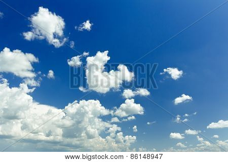 Ultramarine blue heaven background with white ethereal cumulus
