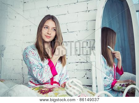 Teen girl combing her hair