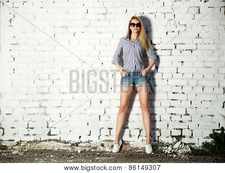 Trendy Hipster Girl at the Brick Wall