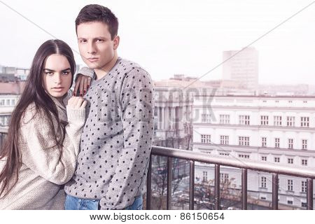 Cute Young Couple In Love On Balcony Terrace