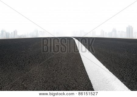 Asphalt Road With White Line And Cityscape