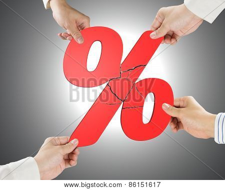 Group Of Business People Assembling Broken Red Percentage Sign
