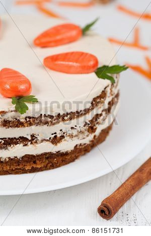 Homemade carrot cake pasrty with icing on white plate