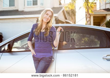 Young woman standing next to her car
