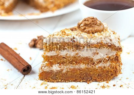 Slice of tasty gourmet vegetable carrot cake dessert food with sweet cream walnut cinnamon and raisi