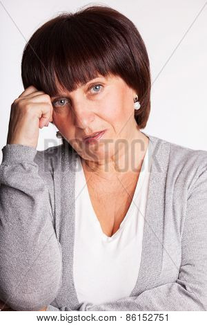 Sad mature woman. Studio shot