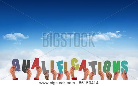 Hands holding up qualifications against bright blue sky over clouds