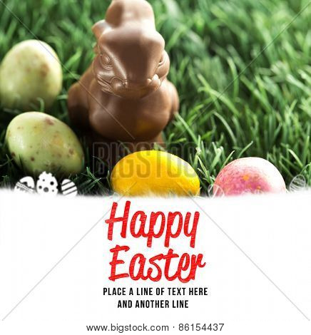 happy easter against chocolate bunny with little easter eggs