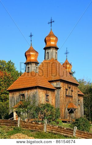 Antique Wooden Church At The Autumn