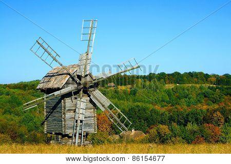 Old Wooden Windmills At Autumn Season
