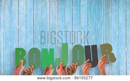 Hands holding up bonjour against wooden planks