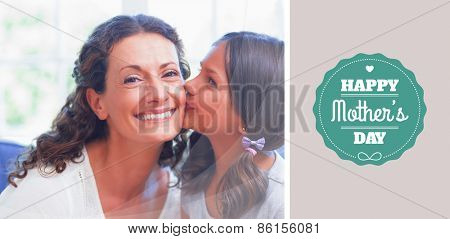 mothers day greeting against cute girl kissing her smiling mother