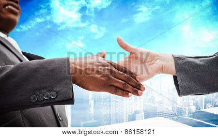 Businessman going shaking a hand against high angle view of city
