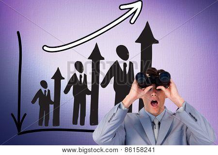 Suprised businessman looking through binoculars against digitally generated grey vignette background