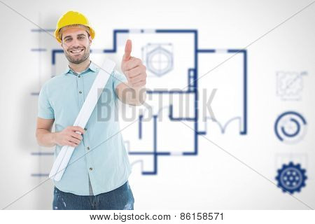 Male architect with blueprint gesturing thumbs up against blueprint