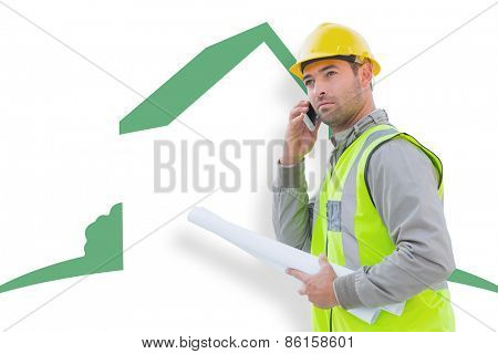 Architect on the phone against house outline
