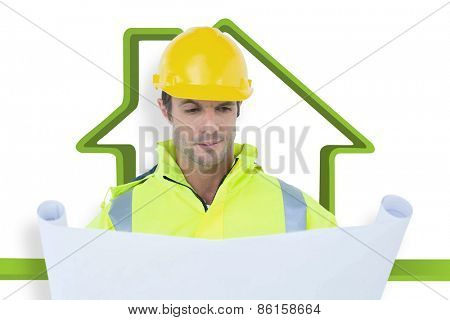 Architect analyzing blueprint against house outline