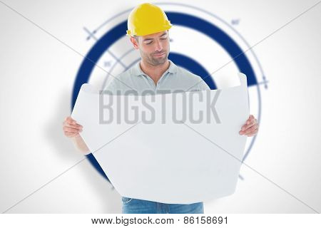 Architect reading plan against blueprint
