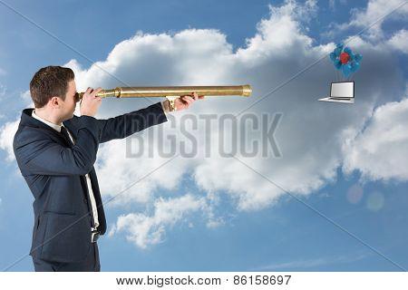 Businessman looking through telescope against cloudy sky