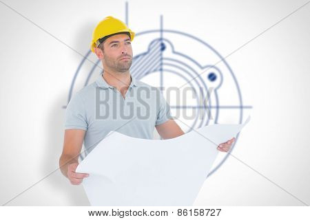 Thoughtful male architect holding blueprint against blueprint