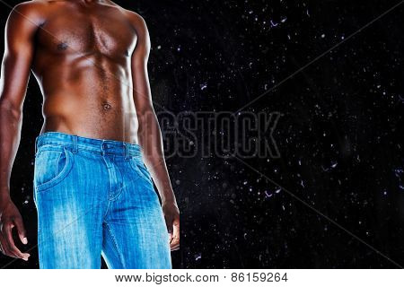 Mid section of shirtless muscular man against black background