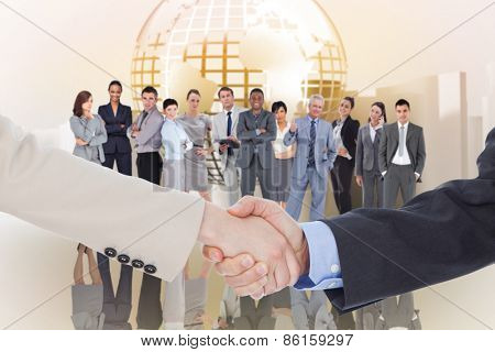 Smiling business people shaking hands while looking at the camera against planet on abstract background