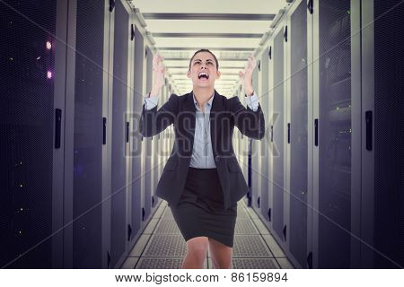 Angry businesswoman gesturing against data center