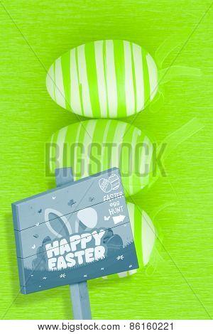 Easter egg hunt sign against three green easter eggs
