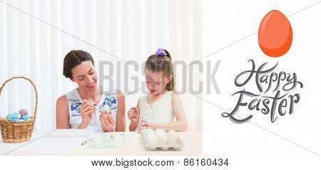 Mother and daughter painting easter eggs against happy easter