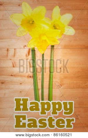 happy easter against pretty yellow daffodils with stems