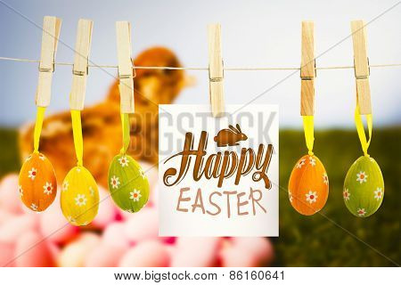happy easter graphic against stuffed chick with easter eggs