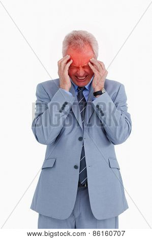 Mature tradesman experiencing a headache against a white background
