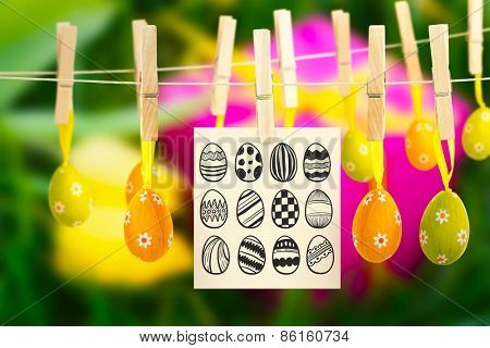 easter eggs against pink gift box and yellow tulips