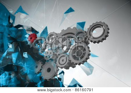 Cogs and wheels against angular design