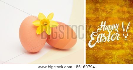 Happy easter against yellow paint splashed surface