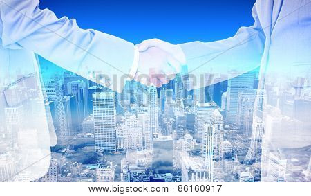 Side view of shaking hands against high angle view of city