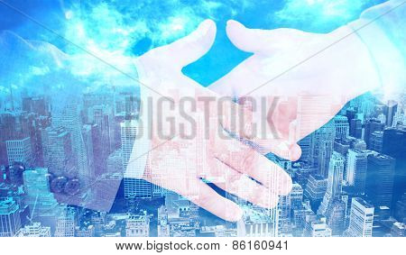Two people going to shake their hands against high angle view of city