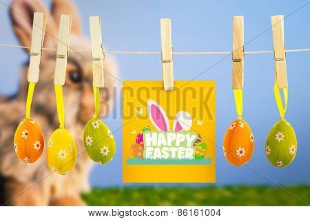 happy easter graphic against grey bunny rabbit