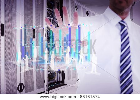 Handsome businessman gesturing with hand against data center