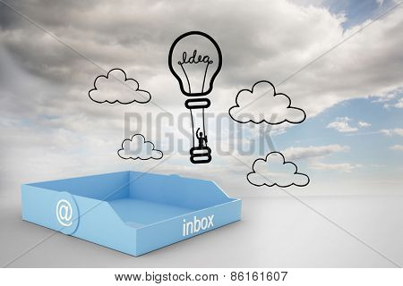 Blue inbox against idea hot air balloon on blue sky